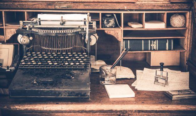 Old Desk with Vintage Typewriter. Aged Desk.